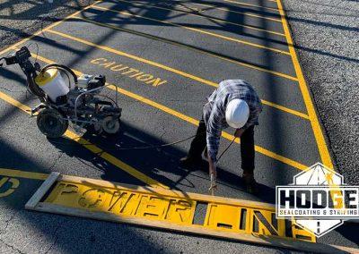 Caution Power Line Striping